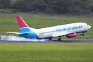 A Flysafair 737 cutting it close on a nose-high approach on a very win...