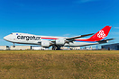 Side shot of Cargolux 747-8 freighter cargo right on touchdown on runw...