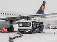 Lufthansa Airbus A321 being fueled during heavy snowfall at MUC.