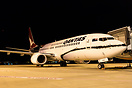 "One of Qantas's special scheme 737's ""Mendoowoorrji"" parked on the gat..."