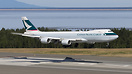 A Cathay Cargo Boeing 747-8F floats over the threshold of runway 07R a...