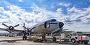 Awaiting the flight crew and now fully loaded an Everts DC-6 sits pati...