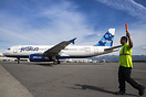 A JetBlue wing walker keep a close on on the progress of an Airbus A32...