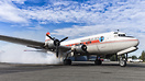 A smokey startup for an Alaskan Air Fuel DC-4 prior to departing Palme...