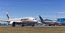 The changing of the guard as a Jetstar taxis past the last Jetstar A-3...