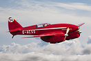 de Havilland Comet Racer above the clouds.