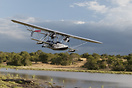 Sikorski S-38B on final approach to land on an African river. Composit...