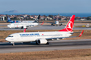 Waiting for departure from runway 36L, while Turkish Airlines Boeing 7...