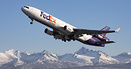 Soaring above the Chugach Range to the east of Anchorage a Fedex MD-11...