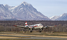 A very heavy Alaska Air Fuel DC-4 eases into the sky at Palmer just ou...