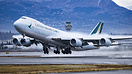 Cathay Pacific Cargo's only new color B-747-8F departs Anchorage after...