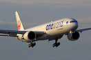 One world livery on a final approach during the golden hour just befor...