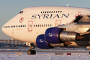 Syrian Boeing 747SP YK-AHB taxi for departure in glorious golden winte...