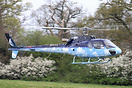 Nick Mason of Pink Floyd about to land in his superbly painted helicop...