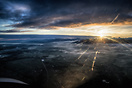 landing at Geneva Runway 05 at sunrise with half of the airport and va...