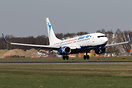 This Blue Air Boeing 737-800 YR-BMH is  promoting flights to 'Liverpoo...