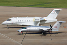 Two corporate aircraft parked on Birmingham's Elmdon apron