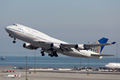 Taking off from runway 28R for United's last revenue 747 flight out of...