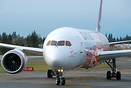 "Head on closeup shot of the colorful Qantas airplane named ""Emily Kame..."