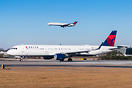 Speeding up on the runway with a Delta MD-80 on final approach in the ...