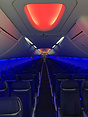 Brand new modern Boeing 'sky' interior with different mood LED lightin...