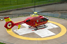 Midlands Air Ambulance Eurocopter EC-135 delivering a patient to the t...