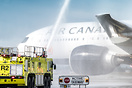 Water cannon salute for pilot retirement.