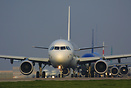 At the head of a queue of aircraft holding for departure on rwy 09R