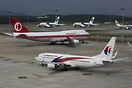 Three variations in the livery of Malaysia Airlines are visible. The A...