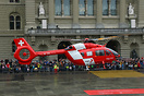 Brand new H145 of REGA Swiss Air Ambulance landing in front of the Fed...