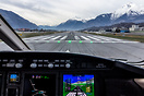 Lined up on RWY25 in Sion, the Synthetic Vision System (SVS) detailing...