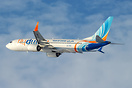 Flydubai departing from Bucharest in a lovely winter light.