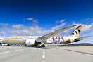 Etihad 787 specially marked for the Abu Dhabi 2019 Special Oympics vis...