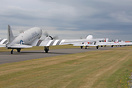 A line up of DC-3's taxi out for departure as part of the D-Day 75th a...