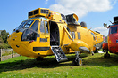 Ex RAF Search and Rescue Sea King awaiting its fate at a yard near Gat...