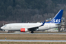 LN-RRB rolling down the runway to vacate off runway 26 at Innsbruck Kr...