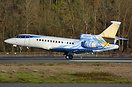 colorful livery Falcon 7X right on touchdown during a golden autumn/ f...