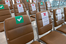 Social distancing markings on chairs in Bangkok Airport terminal