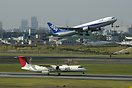 in & out at Osaka Itami, JAC Dash 8 is landing while an ANA B767 is li...