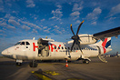 An Hop! ATR 42 at the gate during turnaround