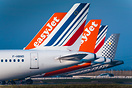 Lineup of tails from various liveries including Easyjet, Air France an...