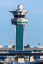 Air Traffic Control Tower from an elevated spot located airside with O...