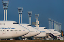 Lineup of four 747s among which three from Corsair International side ...