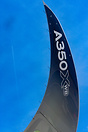 Incredible shape of the A350s wingtip as fellow cruising airliner flie...