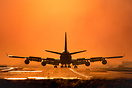 Right behind the runway threshold enjoying the silhouette of this 747 ...