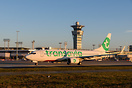 Transavia France Boeing 737 taxiing in the golden morning light passin...