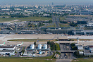 Paris Orly airport overview with the skyline of Paris in the backgroun...