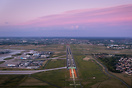 Over runway 07/25 at dusk with the lighting on