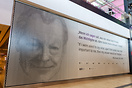 The new Berlin Brandenburg airport features a picture of former German...