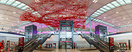 "The airport's centrepiece is ""Flying Carpet"", a 999-metre long red alu..."